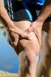 Man grabbing above his knee